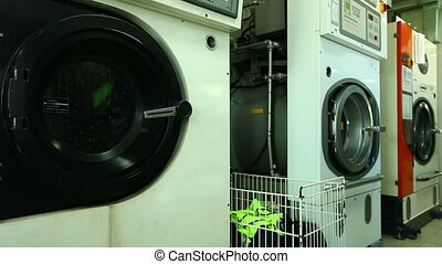 View of working washing machine in laundry - View of working...