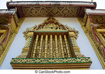 This image shows a Wat detail, window, in Haw Pha Bang...