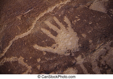 Petroglyph - Depiction of hand pictograph symbol on a rock...