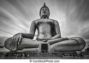Candlelight Makha Bucha Day at Wat Muang with gilden giant...