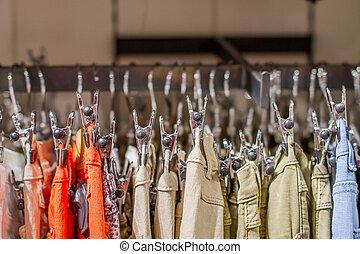 Preview jeans hanging on a hanger in the store - a Preview...