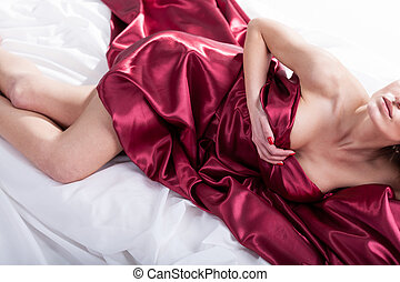 Sensual woman lying in red bedding - Sensual naked woman...