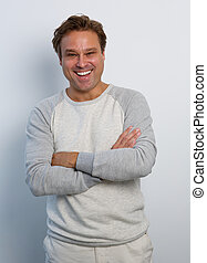 Happy man smiling with arms crossed - Portrait of a happy...