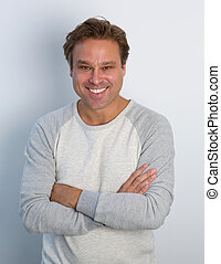 Mature man smiling with arms crossed - Portrait of a mature...
