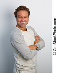 Friendly man smiling with arms crossed - Portrait of a...