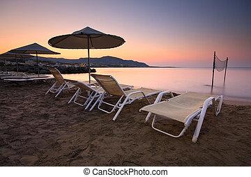 Crete. - Umbrellas on the beach, Crete, Greece.