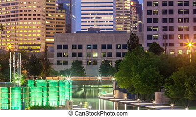 Office building and canal - Indianapolis during sunrise,...