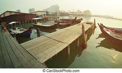 Boats near the old wooden pier Malaysia, Penang, Georgetown...