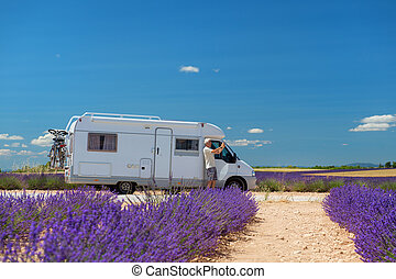 Traveler with mobile home at lavender fields in France - man...