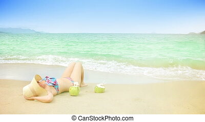 Young woman is relaxing on a beach.