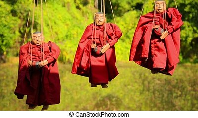 Marionettes - images of Buddhist monks. Inle Lake, Myanmar -...