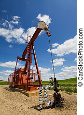 Pump jack - Oil field pump jack on the prairie