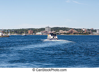 Ferry Leaving Halifax Harbor - A full ferry pulling out of...