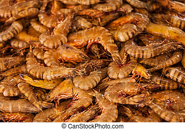 Shrimps close up in market in Asia. Shallow depth of fiels,...