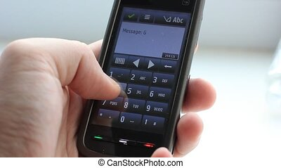 Typing Hello text on smartphone - Male hand typing text on...