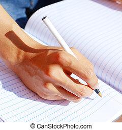 niña, escritura, en, nota, libro