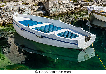 Old white wooden boat in Perast, Montenegro