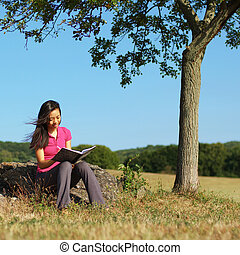 Girl Writing in Note Book