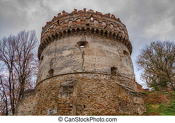 The old-time castle XVI ages. Ostrog. Ukraine Tower of the...