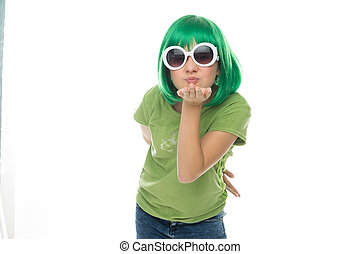 Romantic young girl in a green wig and sunglasses