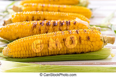 Grilled young corns - Young grilled corn on the wooden table...