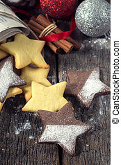 Christmas cookies on wooden table - Selective focus on the...