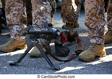 Machine gun and soldier