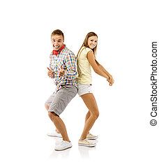 Young couple dancing - Smiling young people dancing,...