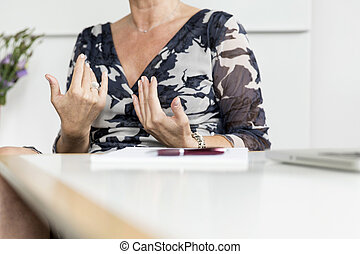 Hands gesturing in conversation - Hands woman gesturing in...