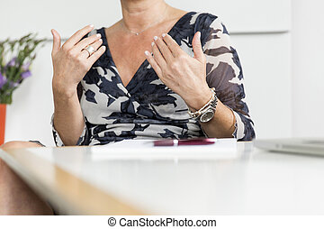 Hands gesturing in conversation - Hands (woman) gesturing in...