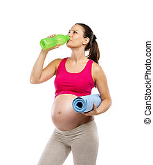 Pregnant fitness woman isolated on white - Studio portrait...
