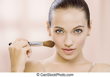 powdering - Portrait of nice young gorgeous woman on pink...