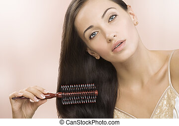 hair - Portrait of nice young woman getting busy with her...