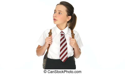 Young schoolgirl standing watching and waiting looking...