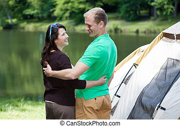 Happy couple on camping