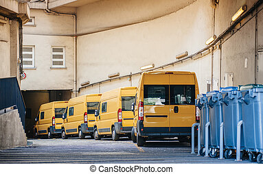 Yellow delivery vans trucks distribution - Row of yellow...