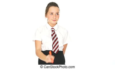 Young schoolgirl writing on a virtual interface - Young...