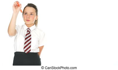 Young schoolgirl writing with a marker pen on a blank...