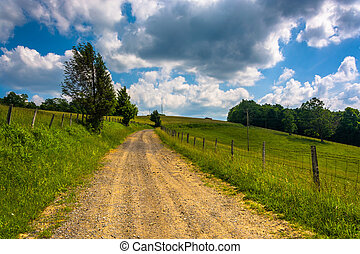 Farm fields along a dirt road in the rural Potomac Highlands...