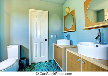 Bathroom vanity cabinets with vessel sinks and round mirrors...