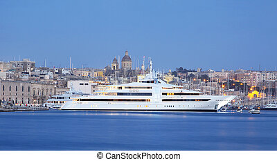 super yacht in a marina - a super yacht berthed in a marina...