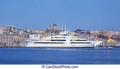 super yacht in a marina - a super yacht berthed in a marina...