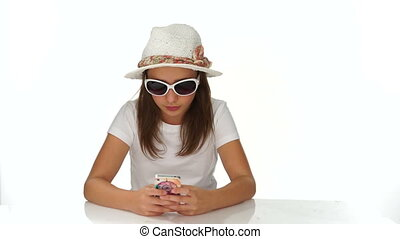 Chic young teenager reading a sms on her mobile - Chic young...