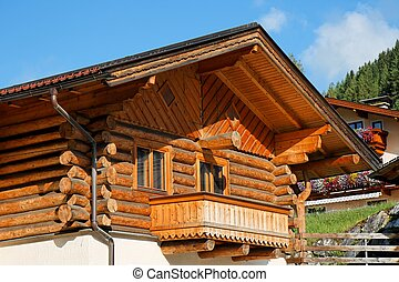 Wooden Alpine chalet with a balcony
