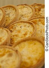 Quiche Lorraine - A tray of small individual quiche lorraine
