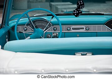 Dash of 1956 Convertible - Dashboard of a classic blue and...