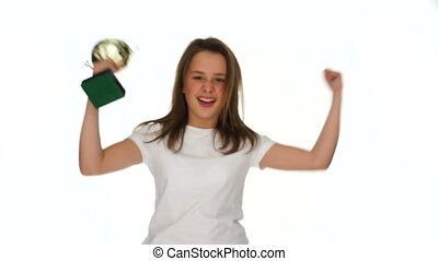 Happy young girl with a sports trophy celebrating her...