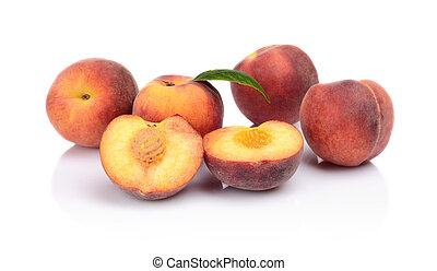 Many peaches with leaf isolated on white