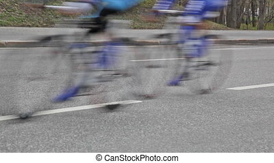 Group of cyclists in action during a cycling tour