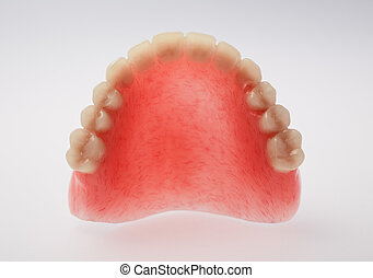 An upper denture on white